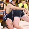 (Brad Davis/The Register-Herald) Independence's Isaiah Duncan takes on Man's Michael Browning in a 145-pound match during the Raider Rumble Saturday afternoon in Glen Daniel. Man's Browning would win the match.