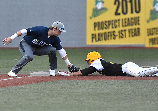 (Brad Davis/The Register-Herald) Miners infielder Kyle Bergeron appears to get tagged on the arm by Butler 3rd baseman Brady Gulakowski before reaching the base but would be called safe Thursday night at Linda K. Epling Stadium.