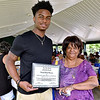 (Brad Davis/The Register-Herald) Former Woodrow Wilson basketball player Isaiah Francis is presented with The Spirit of Change Honor's Award by Juneteenth Committee President Connie McKeever during the 13th Annual Juneteenth Family Cookout Sunday afternoon at New River Park. He'd been bestowed the honor at a previous Juneteenth event, but was away practicing for the North/South All-Star game at the time.