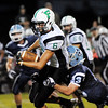 Fayetteville's Kristopher White (6) drags off a would be tackle from Meadow Bridge's Nicholas White (23) during the second quarter of their football game Friday in Meadow Bridge. (Chris Jackson/The Register-Herald)