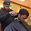 "(Brad Davis/The Register-Herald) Beckley resident David Fernandez gets trimmed up by barber Matt ""Kountry"" Richards at Beckley Barber Shop on South Heber Street Wednesday afternoon."