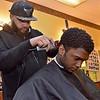 """(Brad Davis/The Register-Herald) Beckley resident David Fernandez gets trimmed up by barber Matt """"Kountry"""" Richards at Beckley Barber Shop on South Heber Street Wednesday afternoon."""
