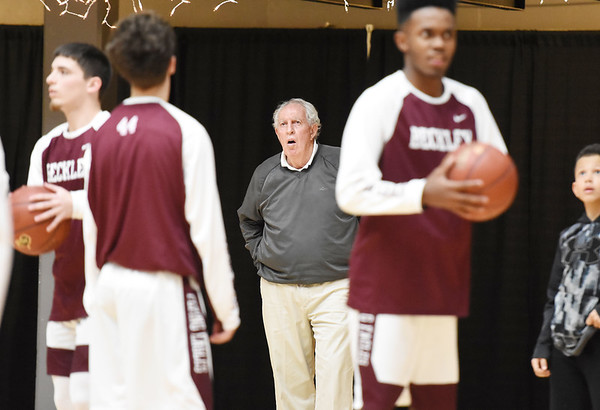 Woodrow Wilson assistant coach Dave Barksdale watches his side warm-up prior to their season opener against Spring Valley Tuesday in Beckley. (Chris Jackson/The Register-Herald)