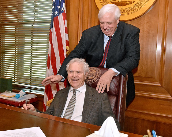 (Brad Davis/The Register-Herald) Rocket Boy Homer Hickam gets an idea of what the view is like from governor Jim Justice's seat inside his office at the conclusion of a meeting between him, Theatre West Virginia's Scott Hill and Allen Media Strategies' Burke Allen (both unphotographed) Monday afternoon in Charleston.
