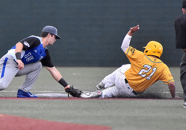 (Brad Davis/The Register-Herald) Miners baserunner Eddy Gonzalez manages to evade the tag at 2nd from Terre Haute infielder Joe Boyle to get the steal Friday night at Linda K. Epling Stadium.