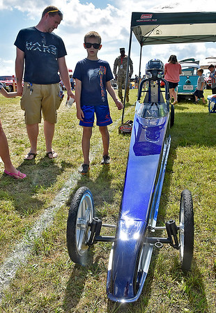 (Brad Davis/The Register-Herald) A young enthusiast gawks at a dragster during the Friends of Coal Auto Fair July 15 at the Raleigh County Memorial Airport.