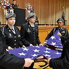 (Brad Davis/The Register-Herald) Cadets from the Fayette Institute of Technology's U.S. Army J.R.O.T.C. program demostrate the sacred 13 folds of the American flag as each one's meaning is read aloud during Fayetteville's annual Veteran's Appreciation Day ceremony at the Fayette County Soldier's and Sailor's Memorial Building Sunday afternoon.