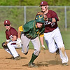 (Brad Davis/The Register-Herald) Woodrow Wilson shortstop Michael Maiolo, right, tags out Greenbrier East baserunner Dylan Wykle after catching him in a rundown between 1st and 2nd during the Spartans' win over the Flying Eagles Monday evening.