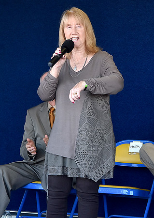 """(Brad Davis/The Register-Herald) Karen Clark, a singer/songwriter from Edmond, sings a song called """"Going to Bridge Day"""" during a ceremony for the New River Gorge bridge's 40th birthday Saturday afternoon."""