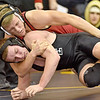 (Brad Davis/The Register-Herald) PikeView's Evan Rose taes on Wyoming East's Michael Elkins in a 160-pound weight class matchup Saturday afternoon at Shady Spring High School. PikeView's Rose would win the match.