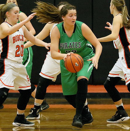 (Brad Davis/The Register-Herald) Fayetteville's Caroline Fenton breaks up court after collecting a rebound against Summers County Thursday night in Hinton.