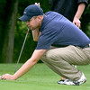 (Brad Davis/The Register-Herald) Brandon Reece prepares for his next putt during BNI action Saturday afternoon at Grandview Country Club.