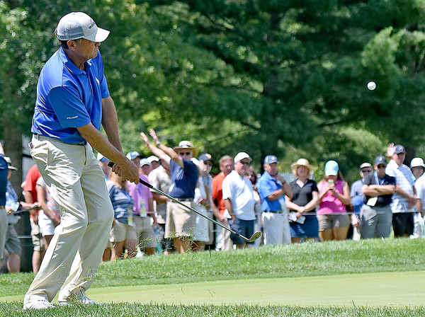 (Brad Davis/The Register-Herald) Davis Love III chips onto a green during final round Greenbrier Classic action Sunday afternoon in White Sulphur Springs.