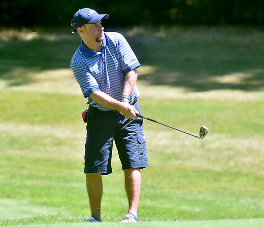 (Brad Davis/The Register-Herald) Shaun Wood chips onto a green during BNI action Sunday afternoon at Glade Springs' Stonehaven Golf Course.