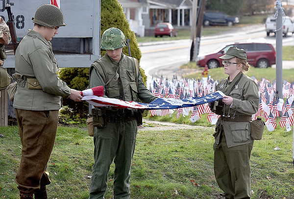 (Brad Davis/The Register-Herald) Area JROTC cadets perform the sacred 13 folds of the American Flag one at a time as the meaning of each is read aloud during the 4th annual Healing Fields Ceremony Saturday afternoon at the Raleigh County Veterans Museum.