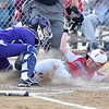 (Brad Davis/The Register-Herald) Independence's Madison Adkins slides to the plate as James Monroe catcher (#0, #30 or #20 possibly?) makes the tag during the 1st inning of the Patriots' game against the Lady Mavs Friday evening in Coal City. Adkins was out on the play.
