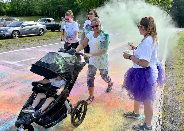 (Brad Davis/The Register-Herald) Participants cross the finish line during the United Way of Southern West Virginia's annual Color Me United Walk/Run Saturday morning at the Raleigh County Memorial Airport.