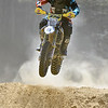 (Brad Davis/The Register-Herald) A competitor catches air as he hits a jump during Sprint Enduro Series dirt bike racing Saturday afternoon at Hidden Valley Golf in Glen Daniel.