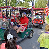 (Brad Davis/The Register-Herald) Carts decked out in red, white and blue decorations make their way through Town Square during a special 4th of July Golf Cart Parade Saturday evening at Glade Springs as part of their 4th of July Celebration weekend.