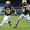 (Brad Davis/The Register-Herald) Shady Spring's Jadon Hershberger carries the ball against Lincoln County Friday night in Shady Spring.