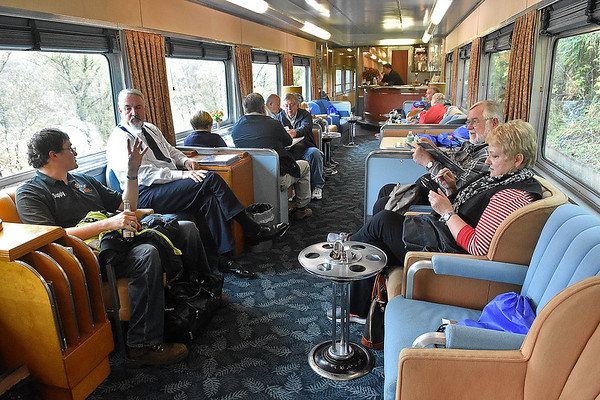 (Brad Davis/The Register-Herald) New River Train excursioneers relax inside one of the silver class cars as they wait to set out on their return trip to Huntington during Hinton Railroad Days Sunday afternoon.