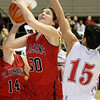 (Brad Davis/The Register-Herald) St. Albans' Haleigh Legg drives and scores as Washington's Roxanne McFarlin defends during Big Atlantic Classic action Thursday afternoon at the Beckley-Raleigh County Convention Center.