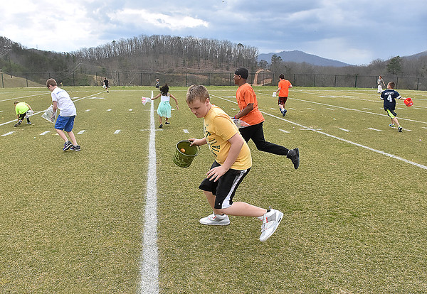 (Brad Davis/The Register-Herald) Youngsters rush the field as they're turned loose for an Easter egg hunt held at halftime of a Spring League game between teams North and South Sunday afternoon in White Sulphur Springs.