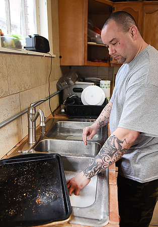 Jimmy Tucker, of Bluefield, washing dishes at Southern West Virginia Fellowship Home on Woodlawn Ave. in Beckley.<br /> (Rick Barbero/The Register-Herald)