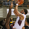 (Brad Davis/The Register-Herald) Woodrow Wilson's Tarek Payne pulls up for a jump shot as Teays Valley Christian's Dylan Ali defends during the opening night of the Battle for the Armory Basketball Tournament Thursday night at the Beckley-Raleigh County Convention Center.