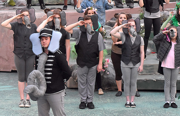 (Brad Davis/The Register-Herald) Colonel Hathe, played by Sam Duggar, patrols to front rows for looking for audience members to recruit into his elephant army during a scene from Theatre West Virginia'a The Jungle Book Kids July 22 at Grandview Park's Cliffside Amphitheatre.