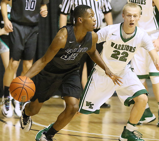 (Brad Davis/The Register-Herald) Independence's Markus Guy looks for an open teammate along the perimeter as Wyoming East's Mcquade Canada defends during Big Atlantic Classic action Wednesday night at the Beckley-Raleigh County Convention Center.