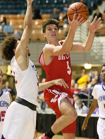 (Brad Davis/The Register-Herald) Parkersburg's Parker Miller drives and scores as Morgantown's Nate Phillips defends during Big Atlantic Classic action Friday night at the Beckley-Raleigh County Convention Center.