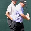 Bubba Watson, left, watches Phil Mickelson miss his birdie putt on the 18th hole during the second round of The Greenbrier Classic.<br /> (Rick Barbero/The Register-Herald.com