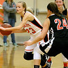 (Brad Davis/The Register-Herald) Summers County's Gavin Pivont speeds around Chapmanville's Kaylee Blair at mid court during the Lady Bobcats' win over the Tigers Saturday night in Hinton.