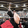 (Brad Davis/The Register-Herald) Liberty senior Brendon Holder gets on a chair and lets the silly string fly as he and graduating classmates erupt in celebration at the conclusion of the school's 40th Commencement Saturday morning at the Beckley-Raleigh County Convention Center.