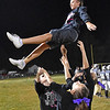 (Brad Davis/The Register-Herald) A Westside cheerleader comes down for a perfect landing after being tossed into the air Friday night in Clear Fork.