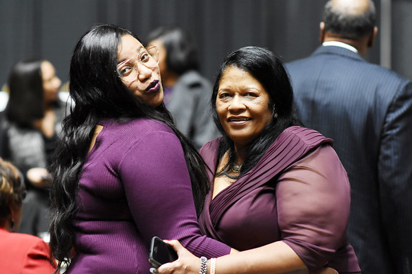 Alea Simms, Bishop Fred T. Simms daughter and his wife Marilyn Simms, during the 31st annual Spirit of Beckley Award at the Beckley-Raleigh County Convention Center in Beckley on Monday. (Chris Jackson/The Register-Herald)