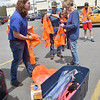 (Brad Davis/The Register-Herald) Piney Creek Watershed Association's David Stewart, left, distributes vests and gear to volunteers who turned out for Raleigh County Make-It-Shine's Spring litter sweep along Harper Road and surrounding areas Friday afternoon in the parking lot of Kroger.