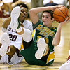 (Brad Davis/The Register-Herald) Greenbrier East's Corey Beswick scrambles for a loose ball with Woodrow Wilson's Mikey Penn Saturday night at the Beckley-Raleigh County Convention Center.