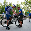 Scout Thomas Flannery, left, 15, from Charleston, has his mountain bike sized by Travis Brown, from Minneapolis,  at the Adventure Zone during the 2017 National Jamboree at The Summit Bechtel Reserve near Mt. Hope. (Chris Jackson/The Register-Herald)