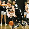 (Brad Davis/The Register-Herald) Westside's Riana Kenneda holds off Wyoming East's Misa Quesenberry as she works along the perimeter during the Renegades' sectional championship win over county rival and defending state champion Wyoming East Wednesday night in Clear Fork.