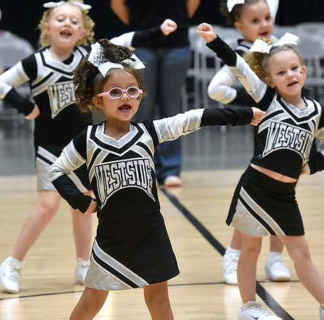 (Brad Davis/The Register-Herald) The Westside Renegades' seven through nine-year-old team performs during a regional cheerleading competition featuring 16 teams at the Beckley-Raleigh County Convention Center Sunday afternoon.