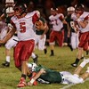 Oak Hill's Christian Lively is tripped up by a Fayetteville defender. Chad Foreman for the Register-Herald