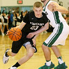 (Brad Davis/The Register-Herald) Westside's Jacob Ellis drives around Wyoming East's Logan Mullins during the second boys meeting of the year in the battle for Wyoming County Friday night in New Richmond.