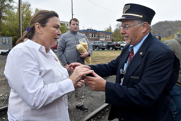 (Brad Davis/The Register-Herald) Borden Black, co-owner of a rail car called The Dearing congratulates Amtrak engineer Dennis Gleason, who was making his last run with the New River Train after 40 years of service on the railways before their return trip to Huntington during Hinton Railroad Days Sunday afternoon.