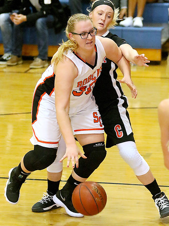 (Brad Davis/The Register-Herald) Summers County's Chloey Davis gets into the paint as Chapmanville's Kara Browning defends during the Lady Bobcats' win over the Tigers Saturday night in Hinton.