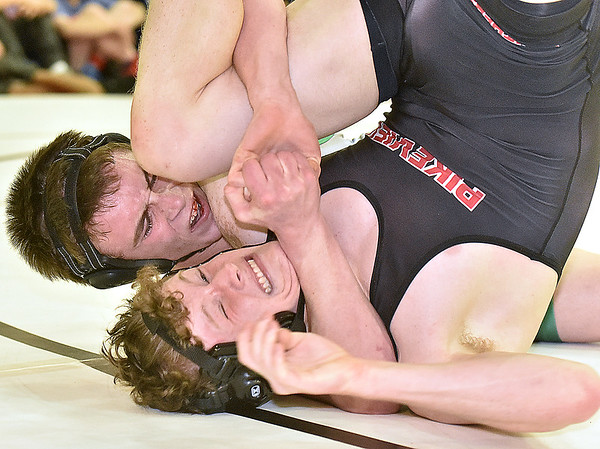 (Brad Davis/The Register-Herald) Fayetteville's Trent Pullens, left, takes on PikeView's Michael McGrady in a 152-pound weight class matchup during the Class AA/A Region 3 Tournament Friday night at Independence High School. Fayetteville's Pullens won the match.