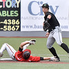 (Brad Davis/The Register-Herald) Greater Beckley Christian's Brandon Williams tries to break up the double play as Charleston Catholic infielder Michael Martin forces him out at 2nd Thursday afternoon at Linda K. Epling Stadium.