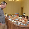 (Brad Davis/The Register-Herald) Scott Lostetter takes a trip down memory lane as he browses the hundreds of photos taken through the years during St. Stephens Episcopal Church Day School's 60th anniversary celebration Sunday afternoon.