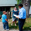Dr. Hassan Amjad, speaks with Marie Collins Buckland, who has lived in Minden for 40-years, about people she has known who have either gotten cancer or died from cancer as one of her sons, Aaron, 8, listens in, Wednesday in Minden. Buckland said all of her immediate neighbors have cancer.  Dr. Amjad is working to compile historical evidence that PCB leaked by the Shaffer Mine has caused devastating havoc on the people of the Fayette County town.
